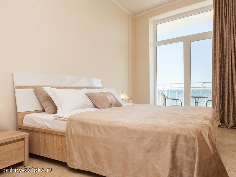 Family two-room with a balcony overlooking the sea